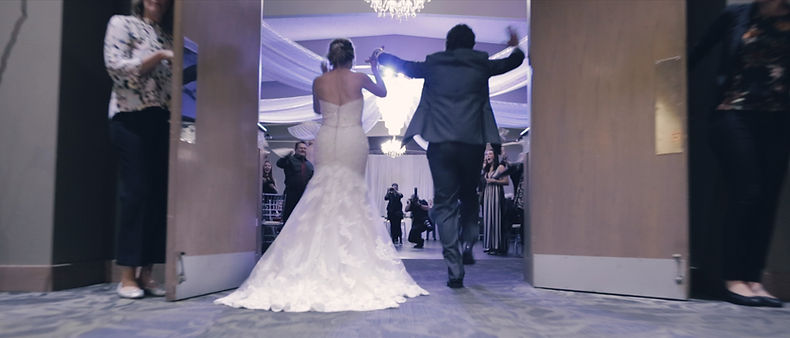 Andrea & Dylan finally making their grand entrance at their wedding reception.