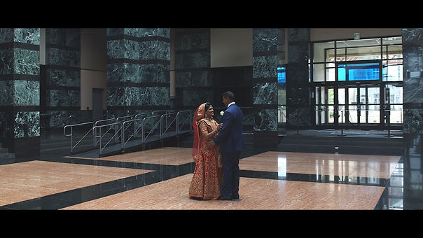 During the video shoot at the Mississauga Civic Centre, the bride and groom rehearse their first dance while Justin and Renata grab a shot.