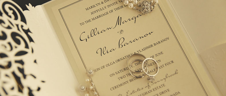Wedding invitation, earrings and the wedding bands