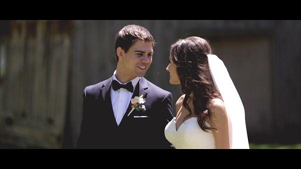 Luke smiles to his beautiful bride Melanie during a video shoot.