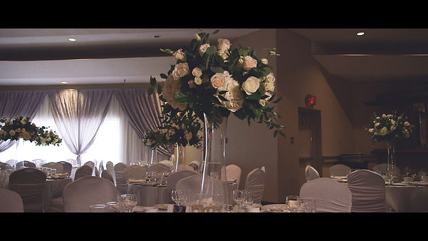 Florals on a centerpiece on tables at the reception held at Capitol Banquet Centre.