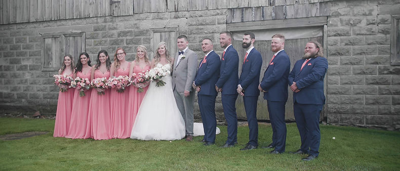 The entire bridal party posing for a photo
