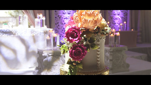Gorgeous detail shot of their wedding cake.