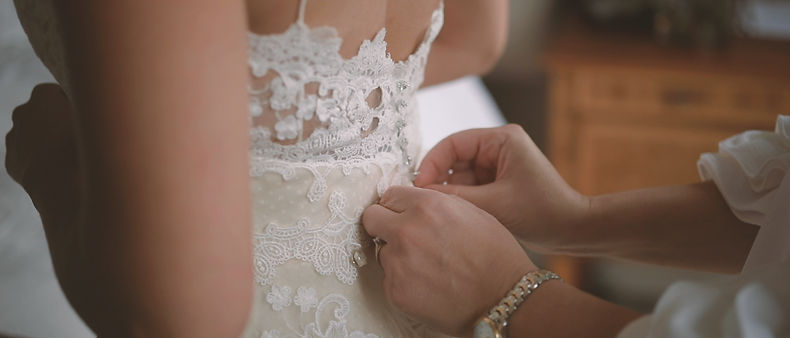 The bride gets dressed at Langdon Hall