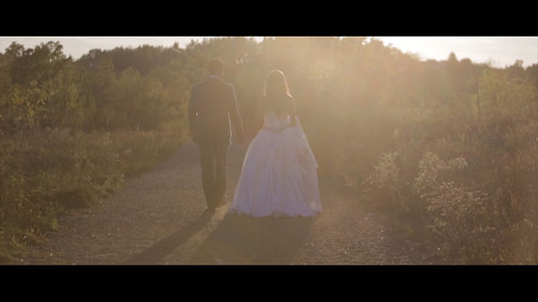 The couple walks hand in hand towards the beautiful sunset, during their photo session in Kitchener, On.