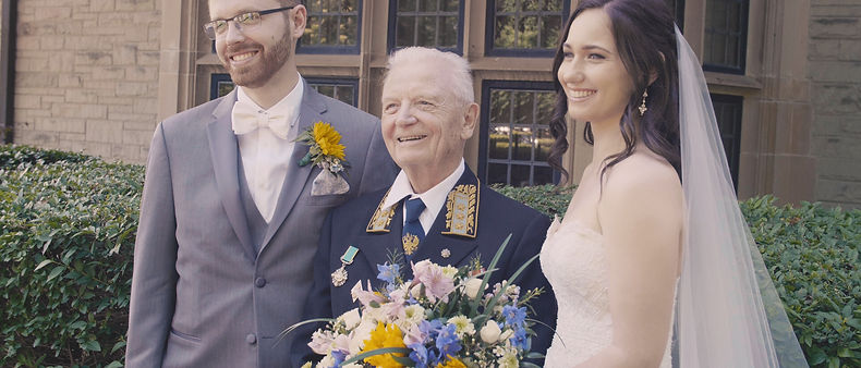 A photo taken with the groom's grandfather