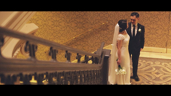 A great video shoot of the couple by the stairs at the Omni King Edward Hotel.