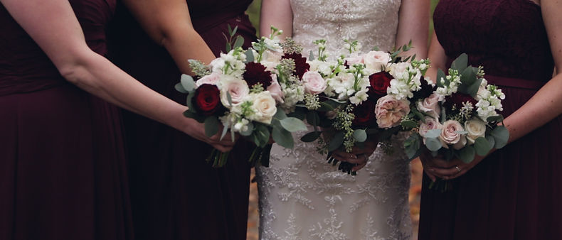 Beautiful bouquets are displayed proudly by the bride, the maid of honour and the bridesmaids.