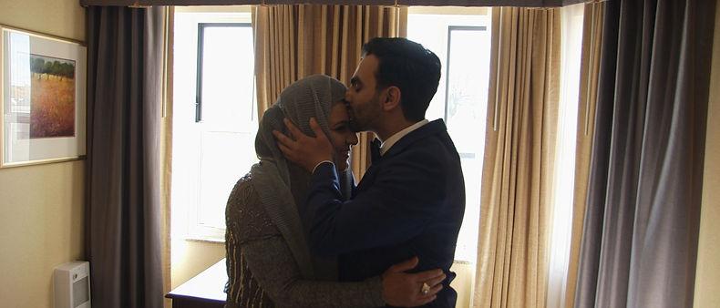 Groom kisses her mom