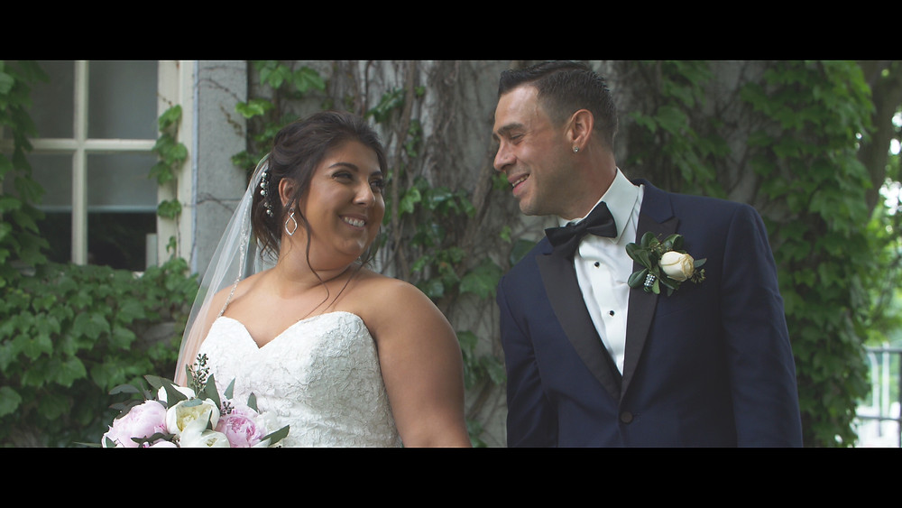 The bride and groom smiling during the video/photo session