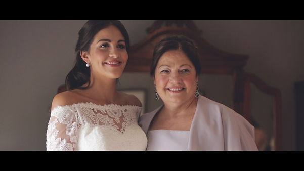 Adrijana with her mother after putting her wedding dress on.