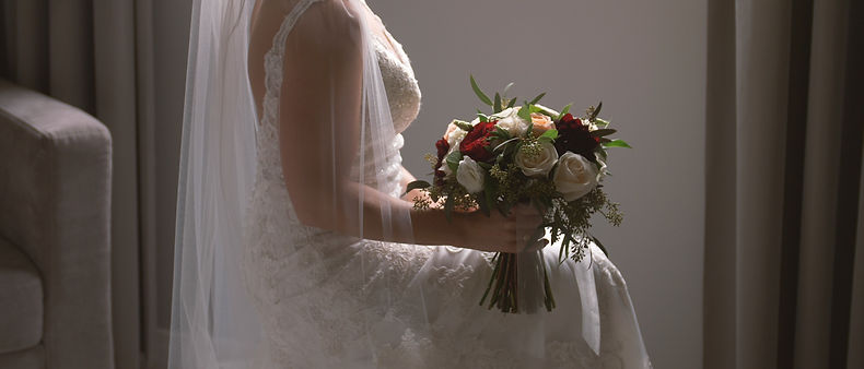 The bride holds the bouquet