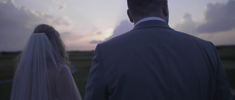 The couple gazing at the sunset