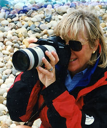 Carolyn and her favorite camera: Canon EOS1 with 70-200mm, 2:8 lens