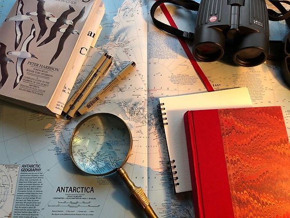 My research tools: Leica binoculars, journal, pens, National Geographic World Atlas, magnifying glass.