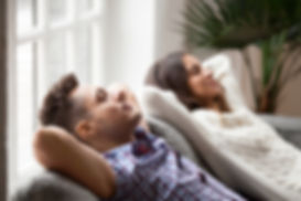 bigstock-Young-Couple-Resting-On-Comfor-