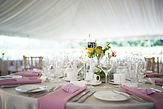 Wedding table setting under white tent