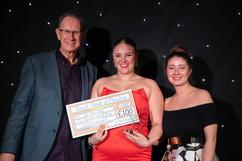 Jim Holmes & Jessica Djemil present Award to