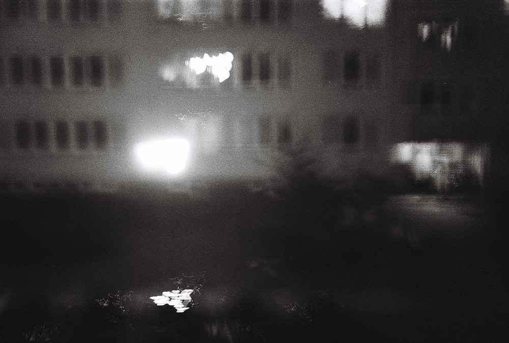 Memory from the Block Part 2 - A blurry, out of focus picture of a building in black and white.