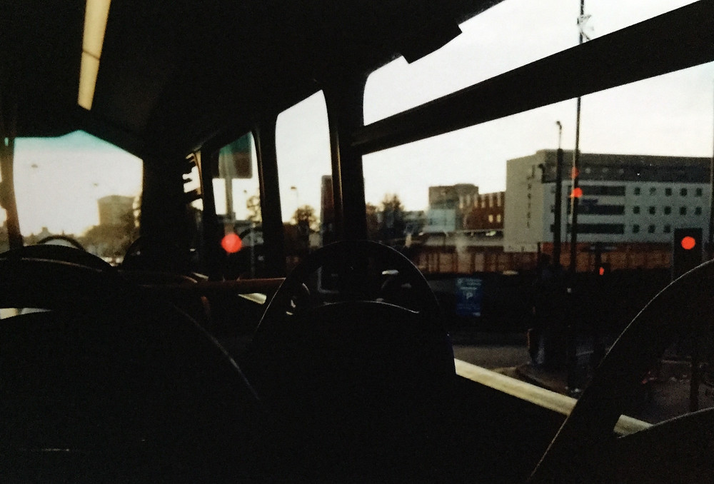 A picture of the inside of a London bus in shadow.