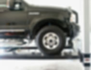 Ford Excursion on 4 Post Car Lift.jpg