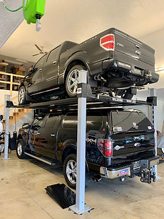 Two Full Size Pick Ups on Car Lift - Wil