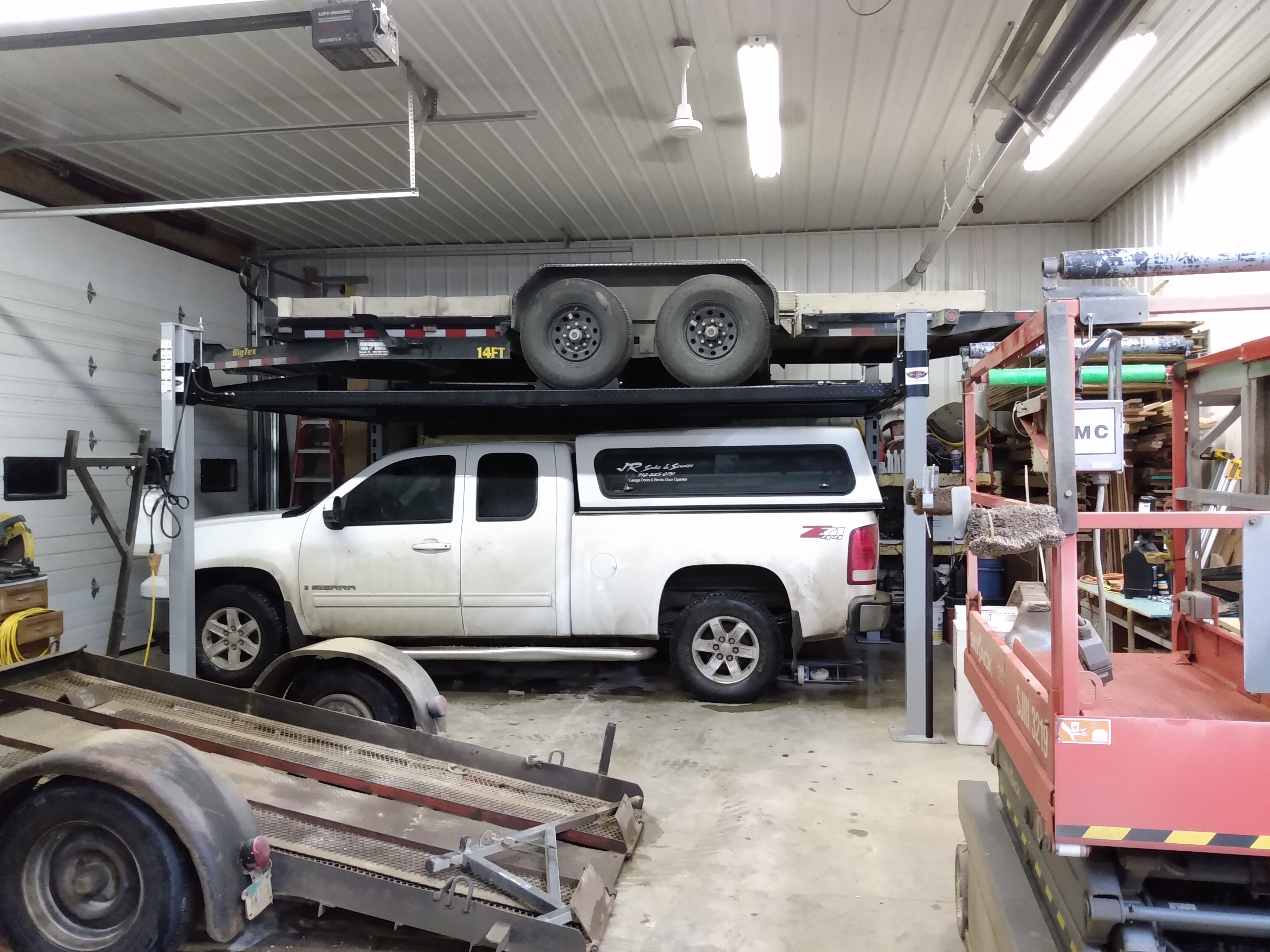 Car Trailer stored on a 4 post lift from