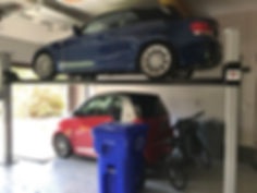 4 Post Car Lift with Smart Car.jpg
