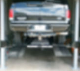 Ford Excursion on 4 Post Car Lift Wildfi