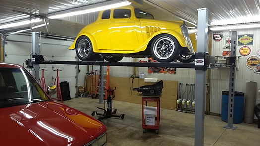 Muscle car on 4 post car lift.jpg