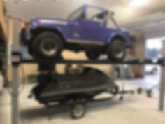 4 Post Car Lift With Jeep and JetSkis.JP