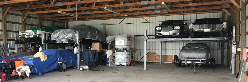 Double Wide Car Lift In Airplane Hangar.