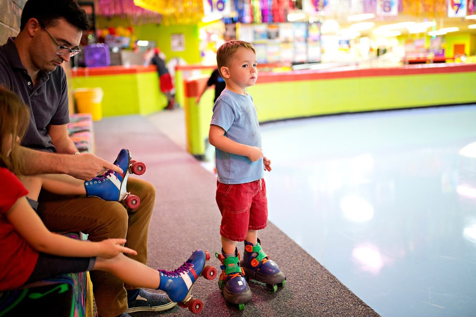 family-roller-skating-at-a-neon-roller-r