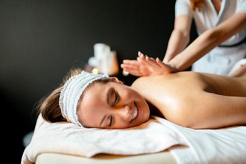 massage-therapist-massaging-woman-AWN6QA