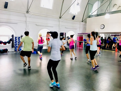 people-at-gym-lunchtime-zumba-class-in-t