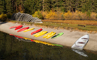 stacks-of-rental-boats-canoes-wait-on-th