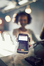 african-waitress-holding-an-electronic-c