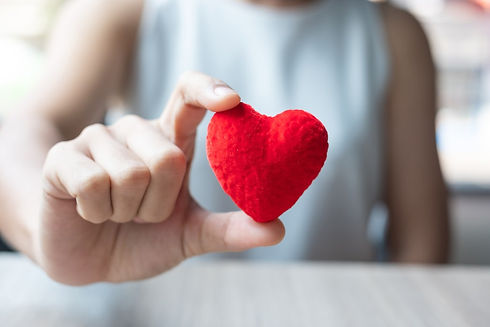 woman-hand-holding-red-heart-shape-in-of