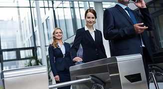 businesspeople-scanning-their-cards-at-turnstile-g-NY5XD3M_edited_edited.jpg