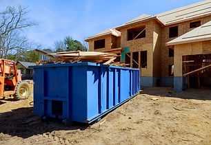 construction-trash-dumpsters-on-metal-co