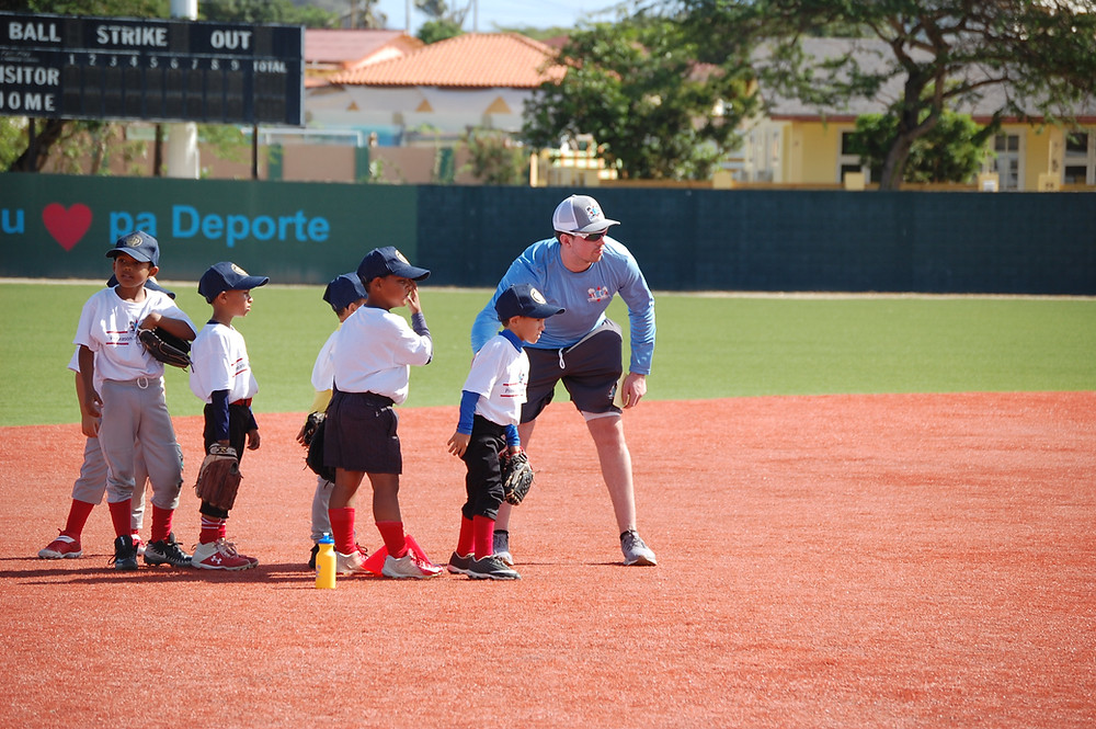 Founder Brodie Carey instructing young infielders