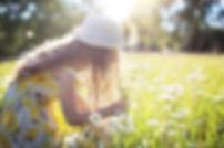 girl picking daisies.jpg