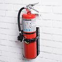 extinguisher on white brick wall.jpg