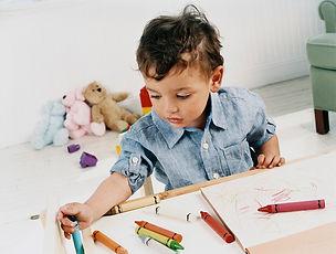 Boy Doodling