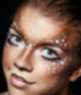 Girl with deer face paint.jpg
