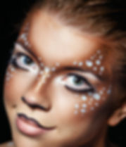 Girl with deer face paint.jpg