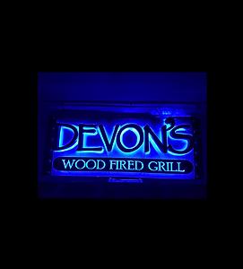 black lighted restaurant sign.png