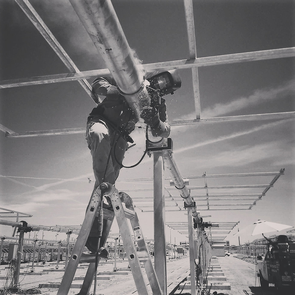 welder fabricating a building frame
