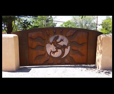 rustic metal entrance gate.png