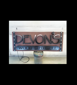 sign with black iron on wood.png